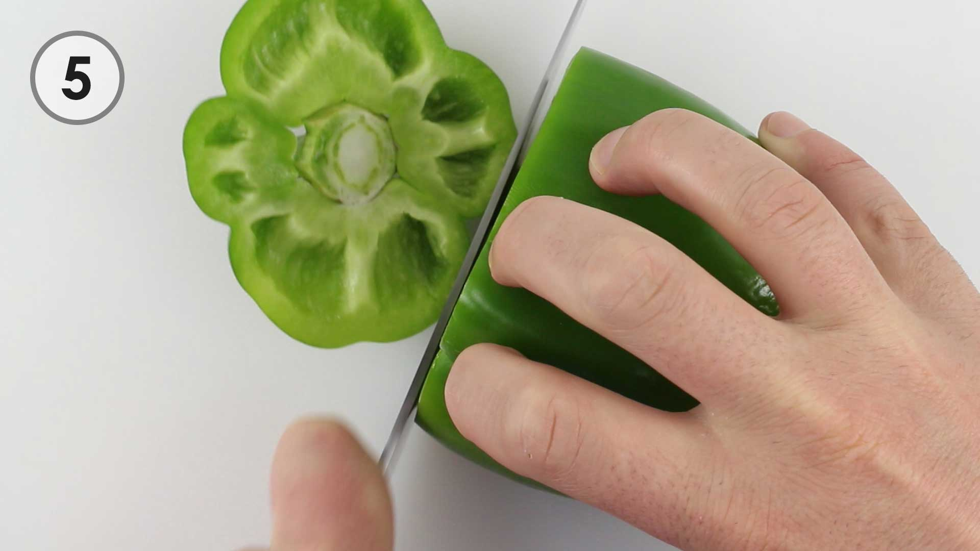 Step 5. Slicing off the top of a bell pepper.