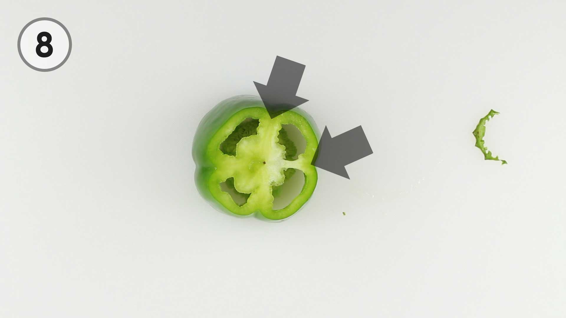 Step 8. Two Arrows point to where the pepper's white inner ribs meet the dark green outside of the pepper.